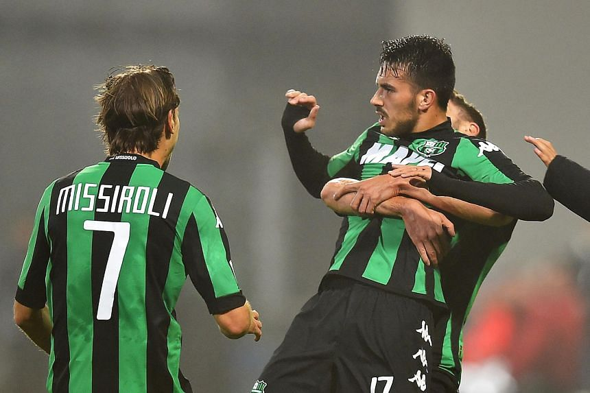 Sassuolo's Nicola Sansone (right) celebrating during the Italian Serie A football match with Juventus on Oct 28, 2015.