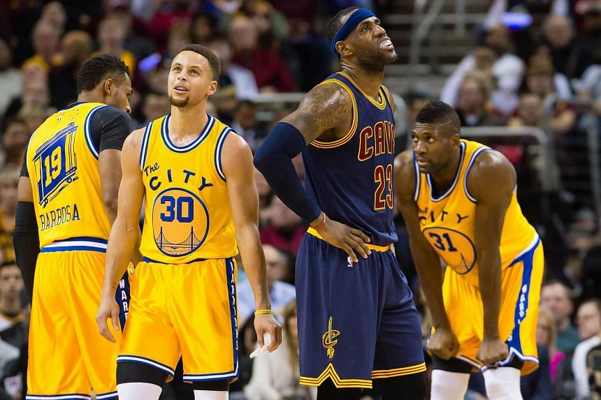 Golden State Warriors' Stephen Curry and Cleveland Cavaliers' LeBron James reacting during the first half on Jan 18, 2016.