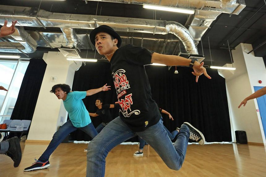 Students from ITE College East practising breakdancing for an annual dance concert.