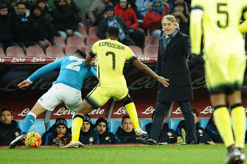 Roberto Mancini gestures during the Italian Cup quarter final football match between Napoli and Inter.