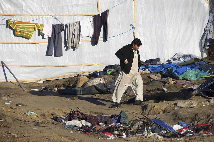An Afghan migrant walking among a dismantled area of a squalid sprawling camp in Calais, northern France, on Jan 19, 2016.