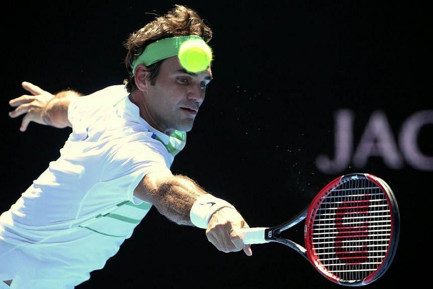 Roger Federer hits a shot during his second round match against Alexandr Dolgopolov at the Australian Open.