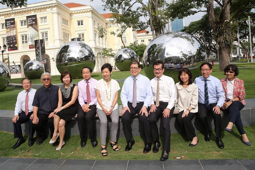 Minister for Culture, Community and Youth Grace Fu (fifth from left) takes a group photograph with guests and artists in front of 24 Hours in Singapore.