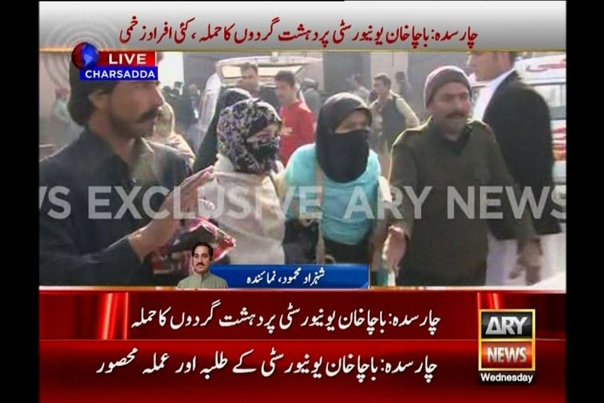 People evacuating from the Bacha Khan University during an attack by militants, in this video still released by ARY News on Jan 20.