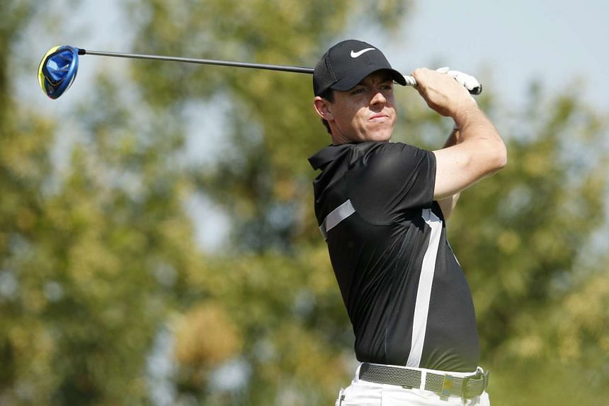 Rory McIlroy tees off at the 3rd hole during the Abu Dhabi HSBC Golf Championship.