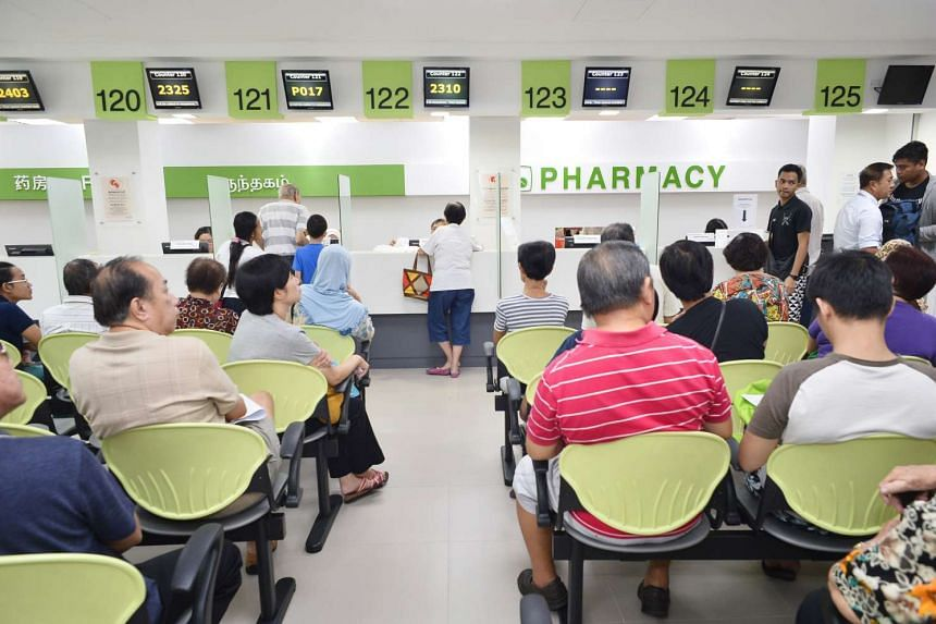 Patients waiting for their medicine at the pharmacy of Tampines Polyclinic.