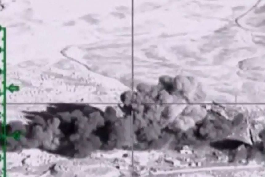 A video grab made on Nov 23, 2015, shows an image purporting to show an explosion after airstrikes carried out by Russian air force on what Russia says was an ISIS facility in Deir al-Zor, Syria.