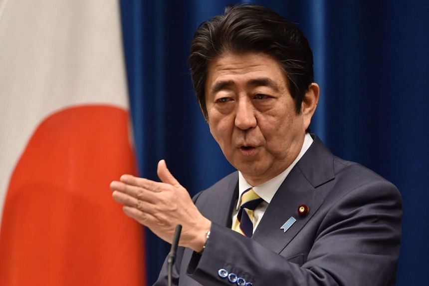 Mr Shinzo Abe answers questions during his New Year press conference at his official residence in Tokyo.