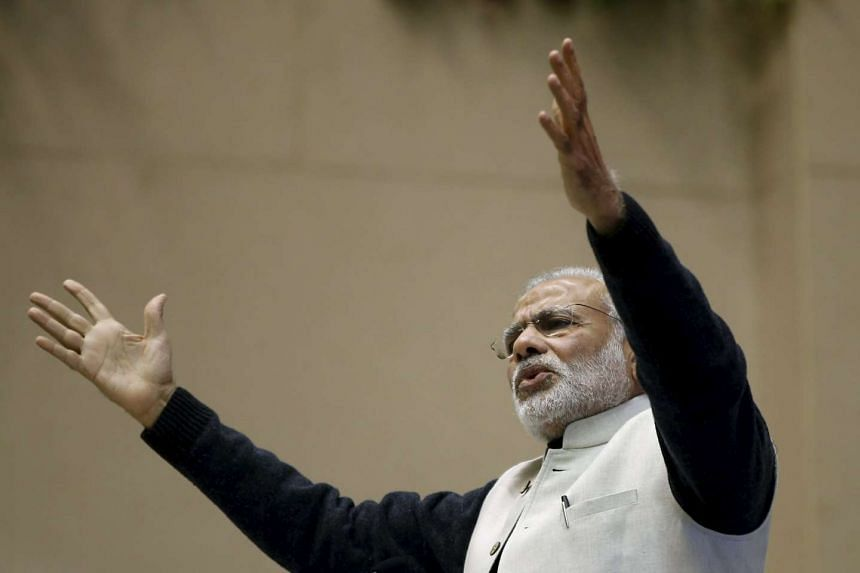 Narendra Modi gestures as he addresses a gathering during a conference of start-up businesses in New Delhi.