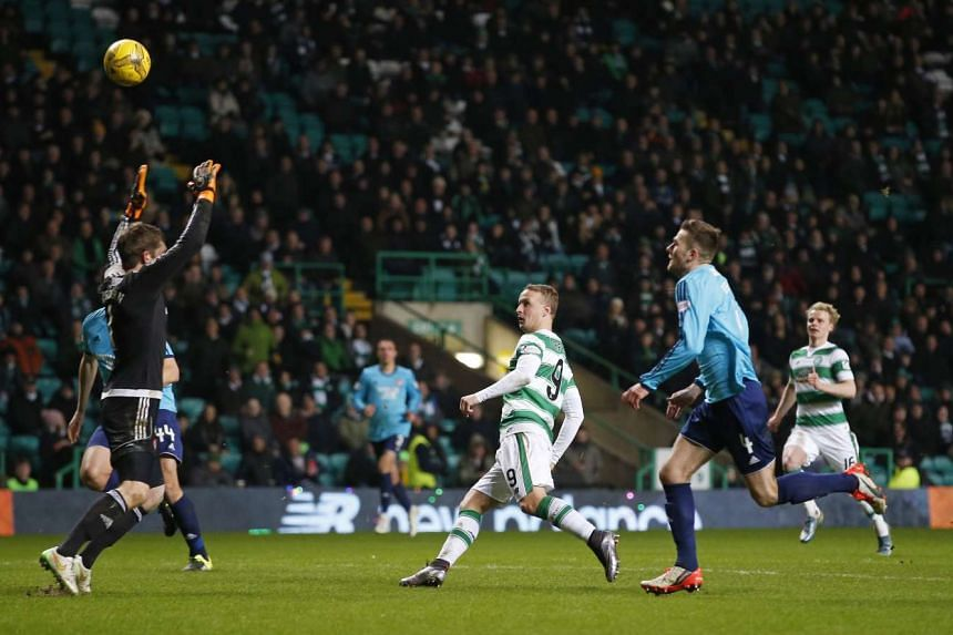 Celtic's Leigh Griffiths scores their seventh goal and completes his hat-trick at the Ladbrokes Scottish Premiership in Celtic Park on Jan 19, 2016.