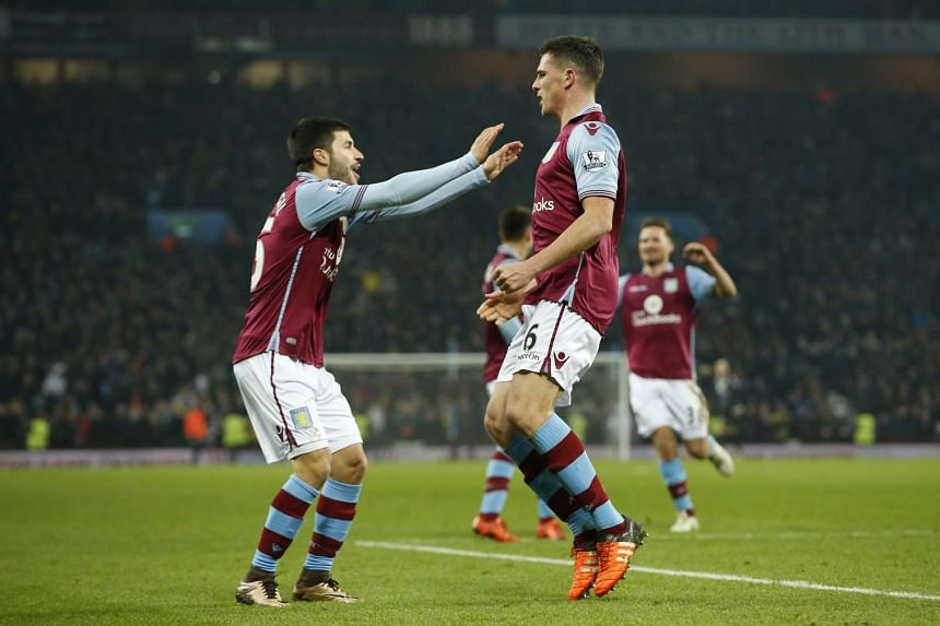 Ciaran Clark celebrates after scoring the first goal for Aston Villa with Carles Gil at the FA Cup Third Round Replay in Villa Park on Jan 19, 2016.