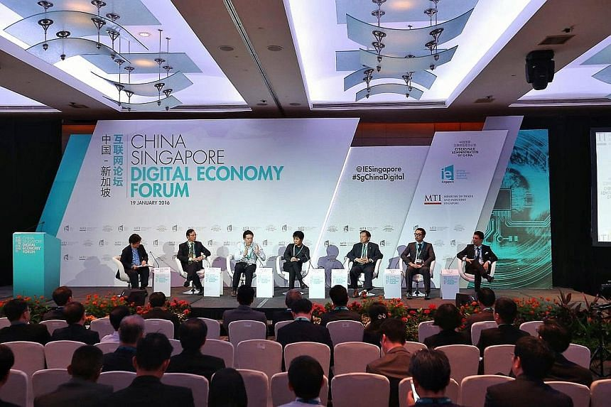 At the China-Singapore Digital Economy Forum yesterday were (from left): Ms Han Yong Hong, Zaobao China news editor (moderator); Mr Tan Tong Hai, StarHub CEO; Mr Zhou Shou Zi, group chief financial officer, Xiaomi; Mr Zhang Qiang, chief operating off