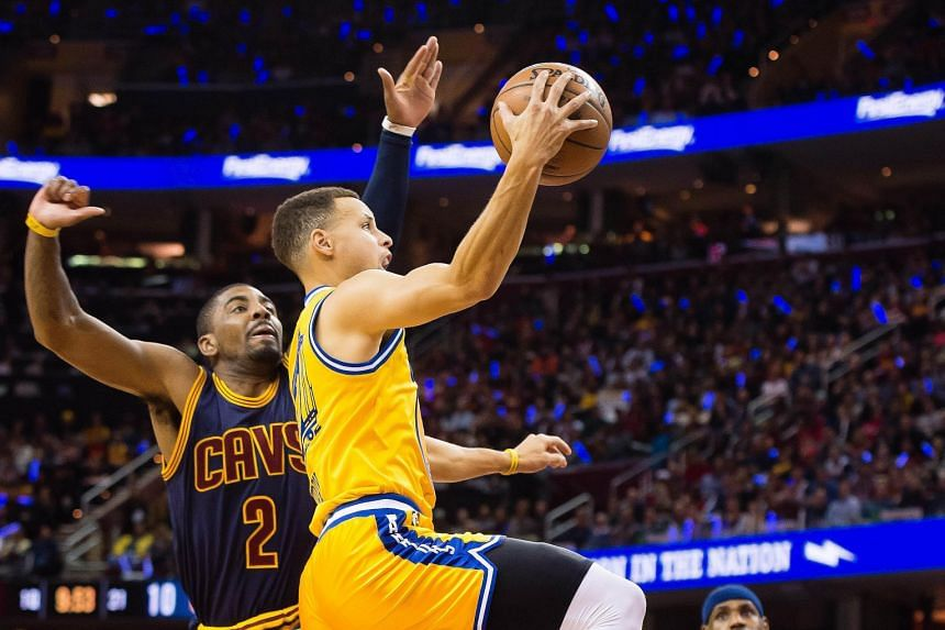 Golden State's Stephen Curry shooting over Cleveland's Kyrie Irving as LeBron James looks on. The 132-98 thrashing in the re-match of last year's NBA Finals saw the Warriors improve to 38-4 for the season while the Cavaliers went to 28-11. The 34-poi