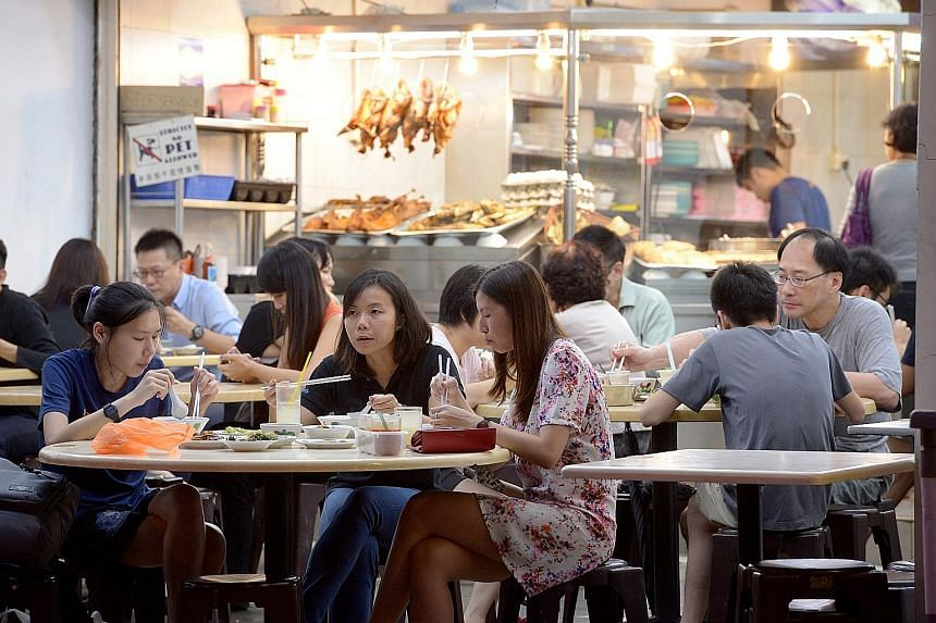Customers at Joo Seng Teochew Porridge and Rice in Cheong Chin Nam Road on Monday evening. Since Downtown Line 2 opened late last month, business has improved for the row of eateries in Cheong Chin Nam Road (above) across the road from Beauty World C
