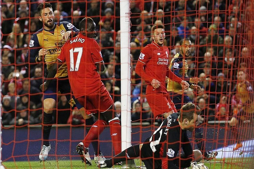 Simon Mignolet is beaten at his near post by Olivier Giroud's (left) poke from a corner during the recent draw with Arsenal. The Liverpool 'keeper has been handed a new contract despite the odd scrappy performance.