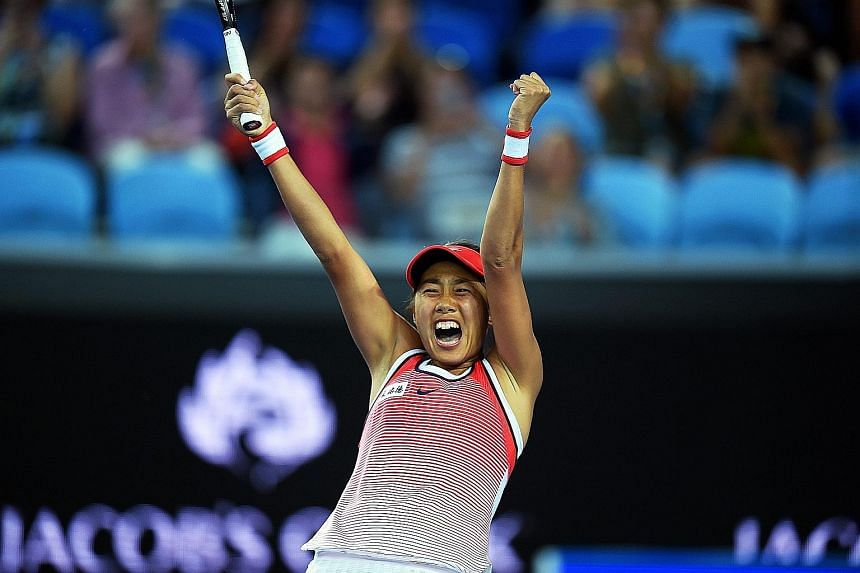 A jubilant Zhang Shuai celebrating her giant-killing act. The Chinese beat world No. 2 Simona Halep for her first Grand Slam win in 15 attempts.