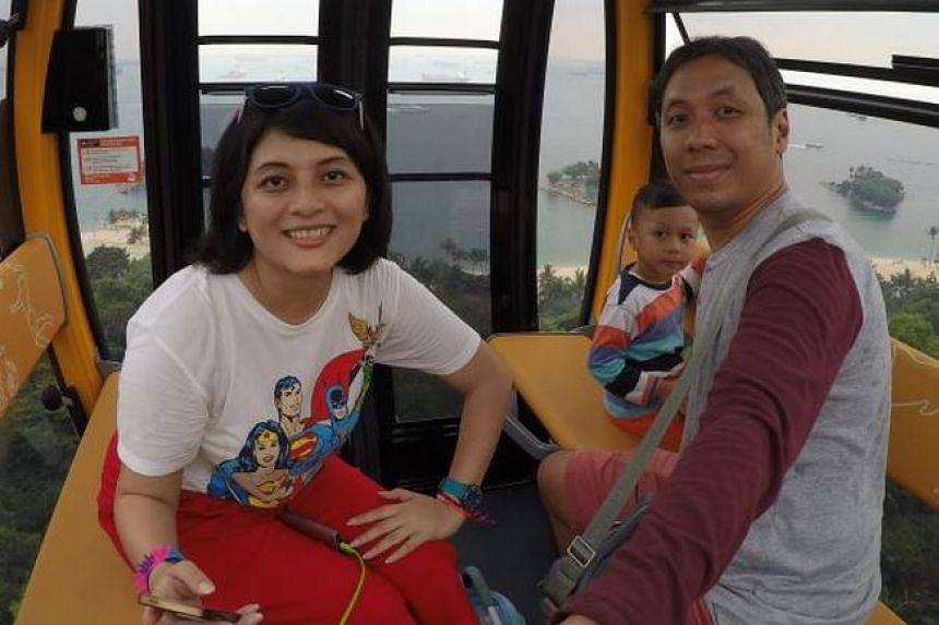 One of the photos in the camera found was this shot of Madam Yuri Nursarasywati (left) with her husband and son in a cable car.