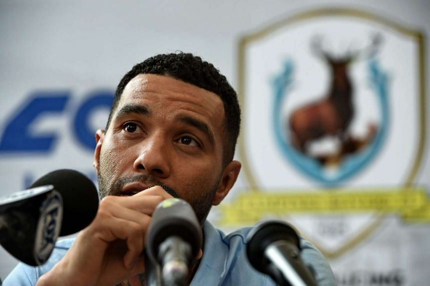 Jermaine Pennant speaks to reporters during the signing ceremony with Tampines Rovers.