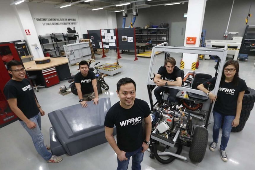 Wong Fong Engineering Works' executive director Eric Lew (foreground, centre) with staff members (from left) Marshall Leong, Clinton Chua, Jasper Galvin and May Por. The firm is working with Williams F1 to build Singapore's first supercar (not in pic