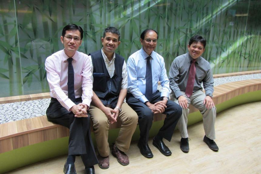 Mr Rajamohan s/o Pekrisamy (2nd from left), Asia's first patient to be implanted with the new HeartMate 3 heart assist device, with the medical team at the National Heart Centre Singapore, from left: Professor David Sim and heart surgeons Dr C Siva