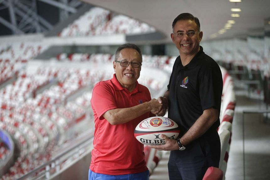 Singapore Rugby Union president Low Teo Peng (left) and Sports Hub CEO Manu Sawhney shaking hands after signing a long-term partnership on Jan 21, 2016.