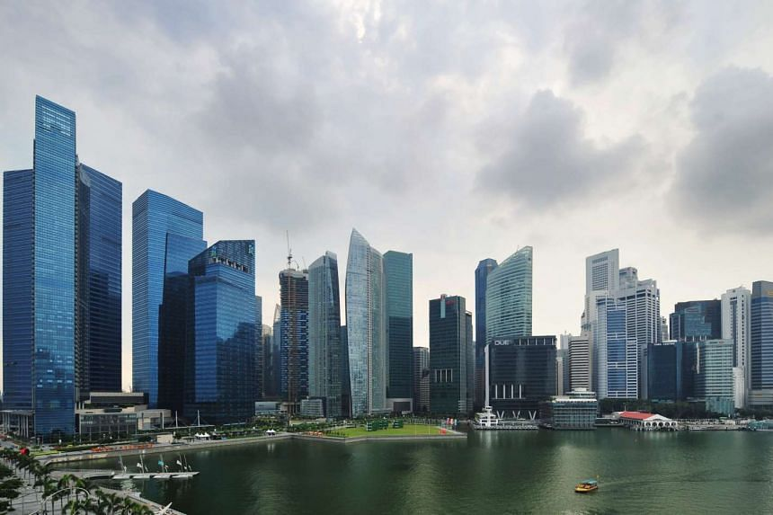 The Marina Bay Financial Centre and other office towers in the Singapore Central Business District.