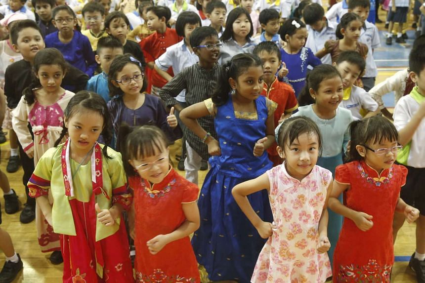 Pupils at Anchor Green Primary School turn up for their classes dressed in their ethnic costumes to mark Racial Harmony Day on July 21, 2015.