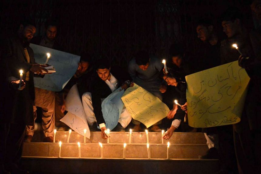 Pakistani students light candles for the victims of Bacha Khan University attack, in Quetta, Pakistan, on Jan 20, 2016.