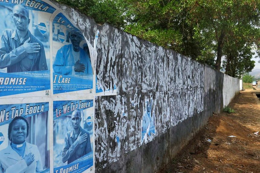 Ebola awareness posters are seen peeling off the wall in Freetown, Sierra Leone, on Jan 20, 2016.