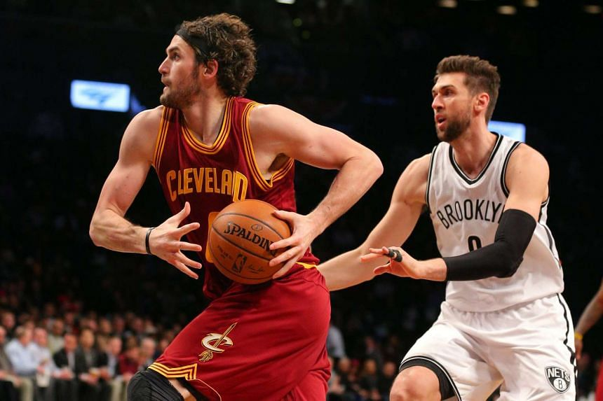 Cleveland Cavaliers power forward Kevin Love drives against Brooklyn Nets center Andrea Bargnani.