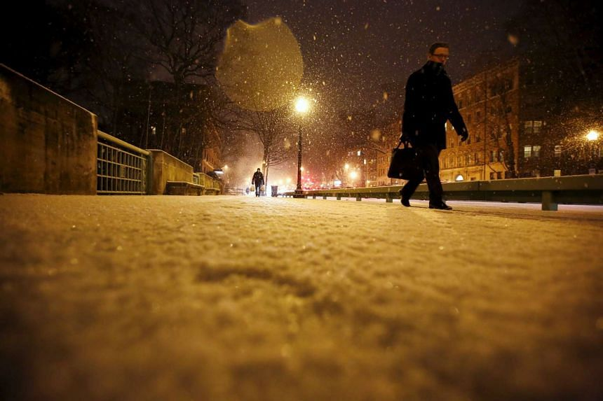 A man walks in the snow in Washington, after a snowfall ahead of a major storm expected to hit the US.