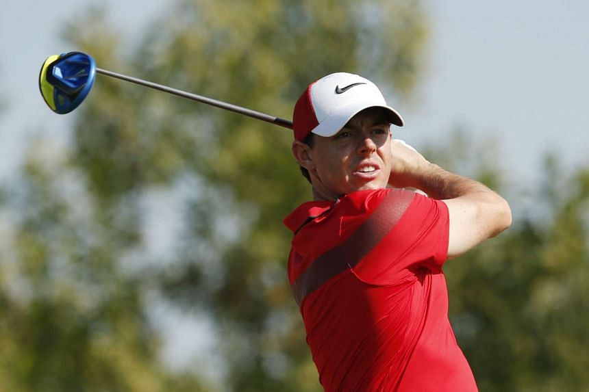 Rory McIlroy tees off at the 3rd hole during the first round of the Abu Dhabi HSBC Golf Championship.