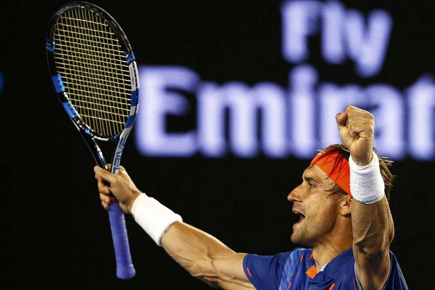 Spain's David Ferrer celebrates after winning his second round match against Australia's Lleyton Hewitt at the Australian Open.
