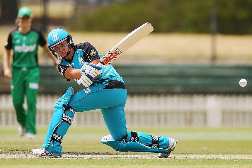 Australian Ash Barty in action for the Brisbane Heat in the Women's Big Bash League last month. The 19-year-old had earned more than US$900,000 in her brief tennis career but the maximum she can expect as a cricketer is about US$6,800.