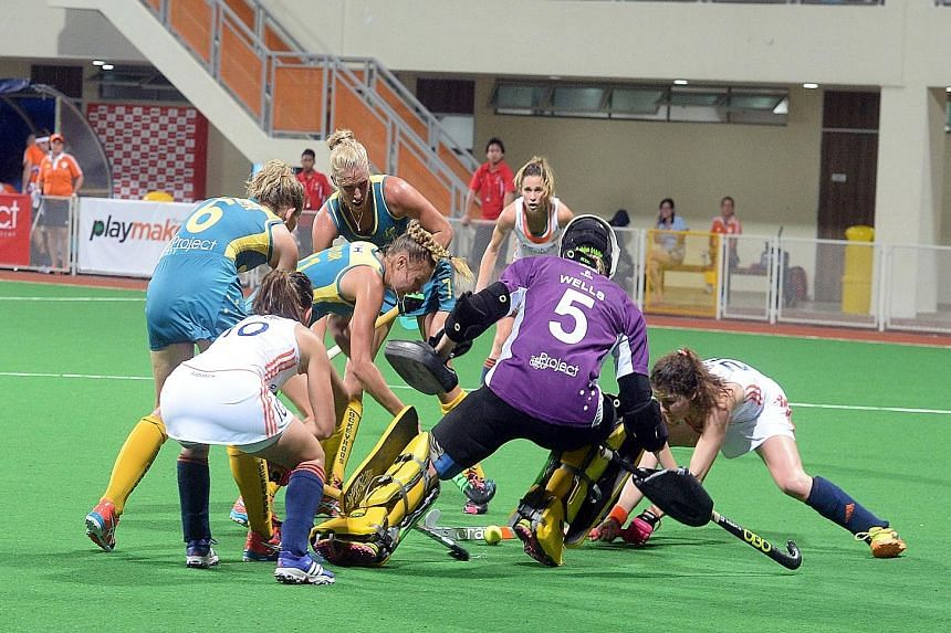 The Netherlands' winning margin would have been larger if not for Australian goalkeeper Ashlee Wells' fine display. She denied the Dutch from close range on several occasions, like in this goal-mouth melee.