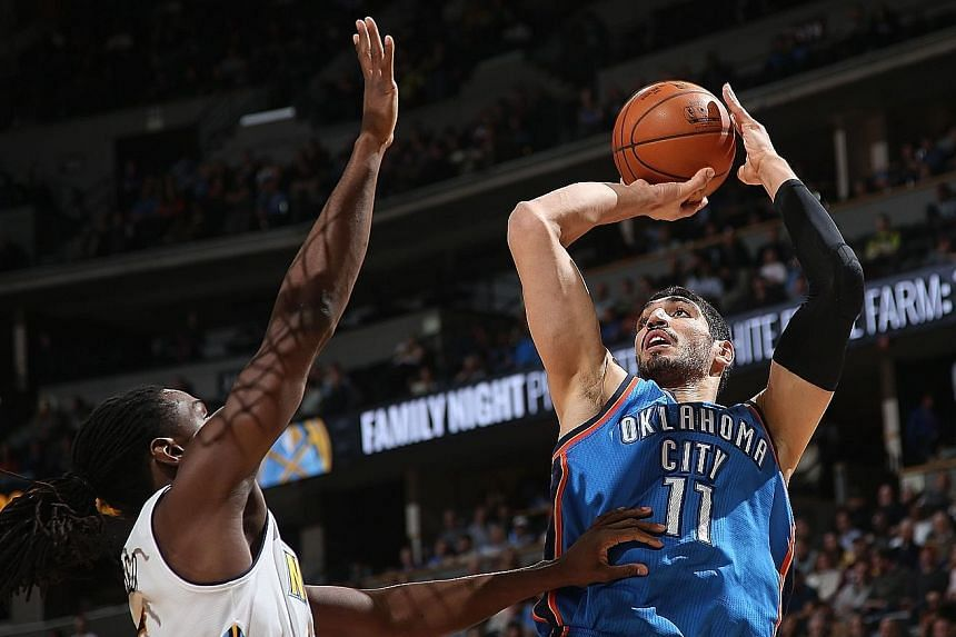 Oklahoma City's Enes Kanter (right) taking a shot over Denver's Kenneth Faried at the Pepsi Centre. The Thunder defeated the Nuggets 110-104.