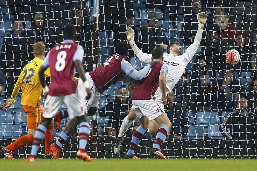 Aston Villa's Ciaran Clark (second from right) heads past Wycombe Wanderers' goalkeeper Matt Ingram to break the deadlock in the 75th minute of the FA Cup third-round replay. Villa won the tie 2-0 to move on to the fourth round.