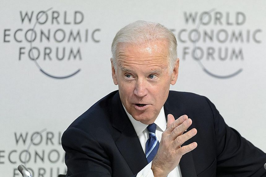 "Mr Biden speaking in Davos on Tuesday about his government's newly announced drive to cure cancer ""once and for all""."