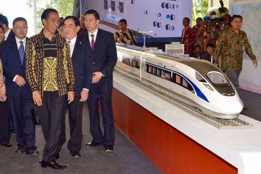 This handout photo released by the Presidential Palace shows Indonesian President Joko Widodo (2nd L) attending a groundbreaking ceremony of the country's first high-speed railway in Bandung on January 21, 2016. PHOTO: AFP