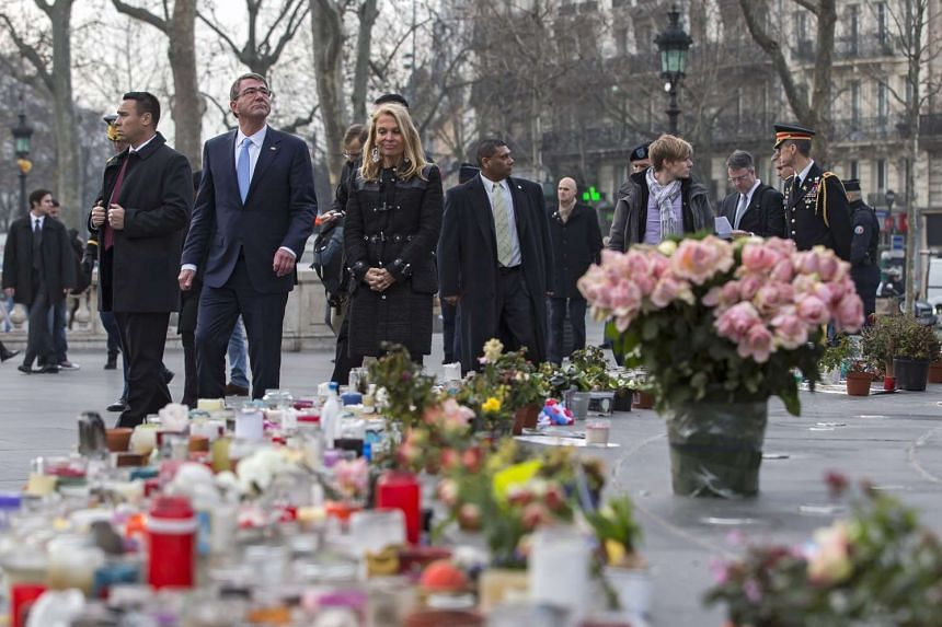 Carter (second left) and US Ambassador to France Jane Hartley (third left) pay their respects to victims of the Paris terrorist attacks.