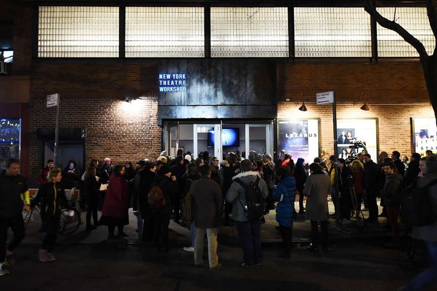 Fans attend a showing of the David Bowie musical Lazarus on Jan 12, 2016, in New York City.
