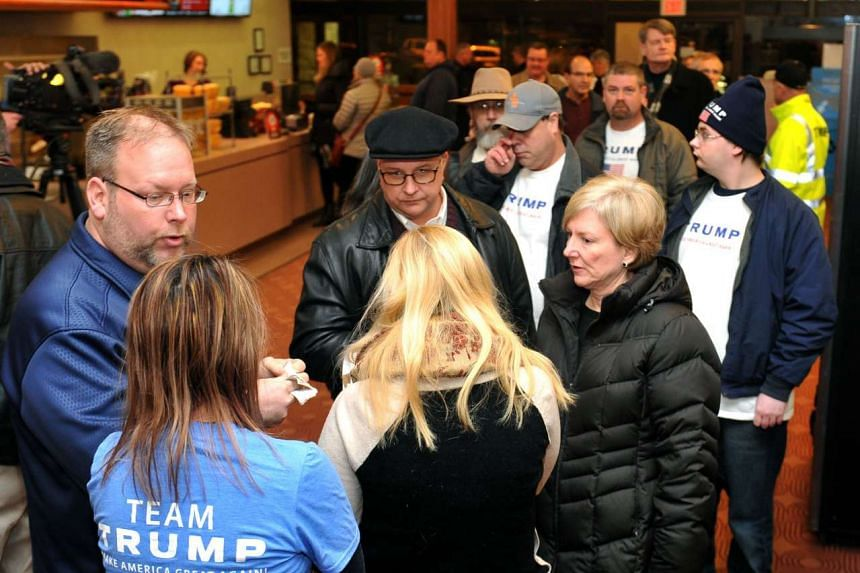 Supporters of Republican presidential candidate Donald Trump wait in line for a free showing of the movie 13 Hours: The Secret Soldiers of Benghazi in Urbandale, Iowa on Jan 15.