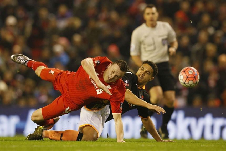 Liverpool's Brad Smith in action with Exeter City's Troy Brown at Anfield on Wednesday.