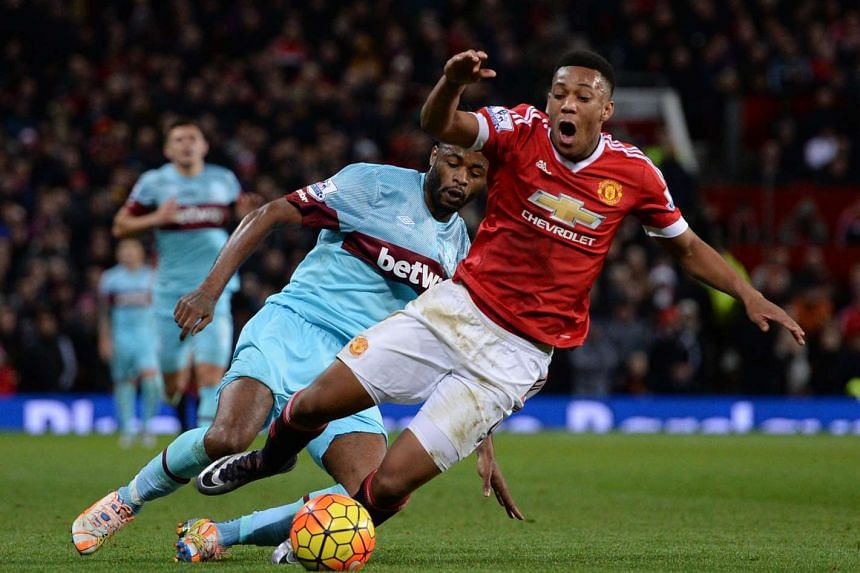 Manchester United's French striker Anthony Martial (right) shifts into high gear against West Ham at Old Trafford on Dec 5, 2015.