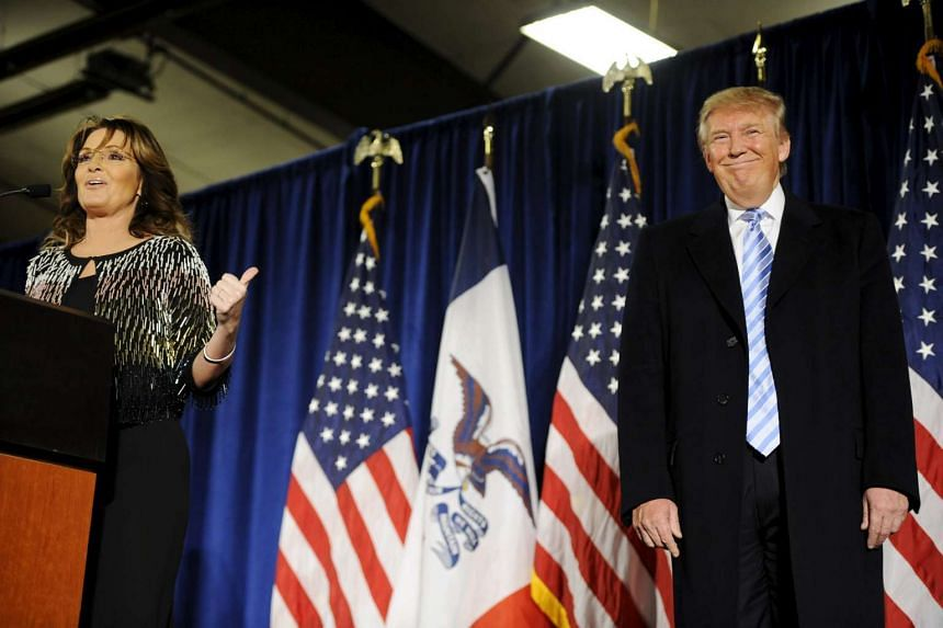 Sarah Palin (left) points to Donald Trump (right) after endorsing him for President of the United States at an Iowa rally on Tuesday.
