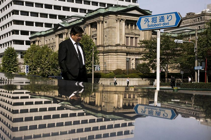 A man walking past the Bank of Japan building in Tokyo.