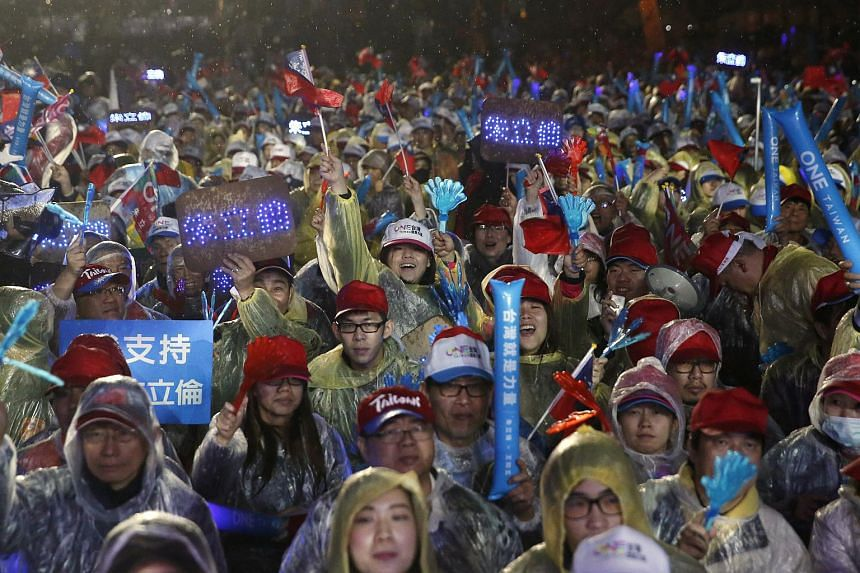 Supporters attending a campaign rally by the ruling Nationalist Kuomintang Party (KMT) chairman Eric Chu a day before the election in Taiwan.