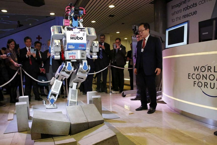 A multifunctional walking humanoid robot performs a demonstration of its capacities in Davos on Jan 20, 2016.