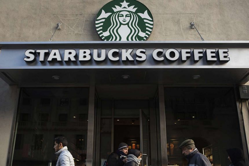 Pedestrians walking past a Starbucks outlet in New York on Jan 17.