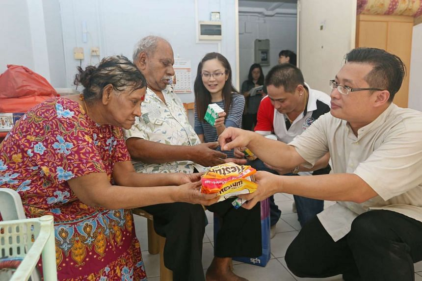 More than 20 SPH staff played games with and gave festive bags to some 120 elderly living in Toa Payoh.